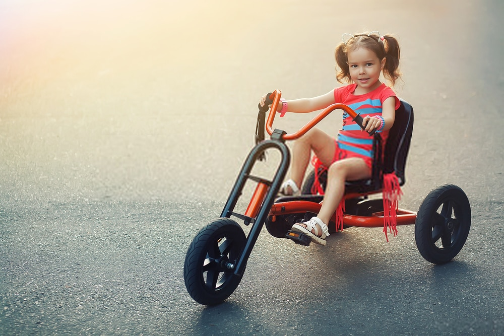 The Radio Flyer Deluxe Steer & Stroll Kids Tricycle