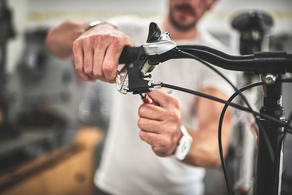 Squeeze the brake lever several times to check where the pads hit the rim