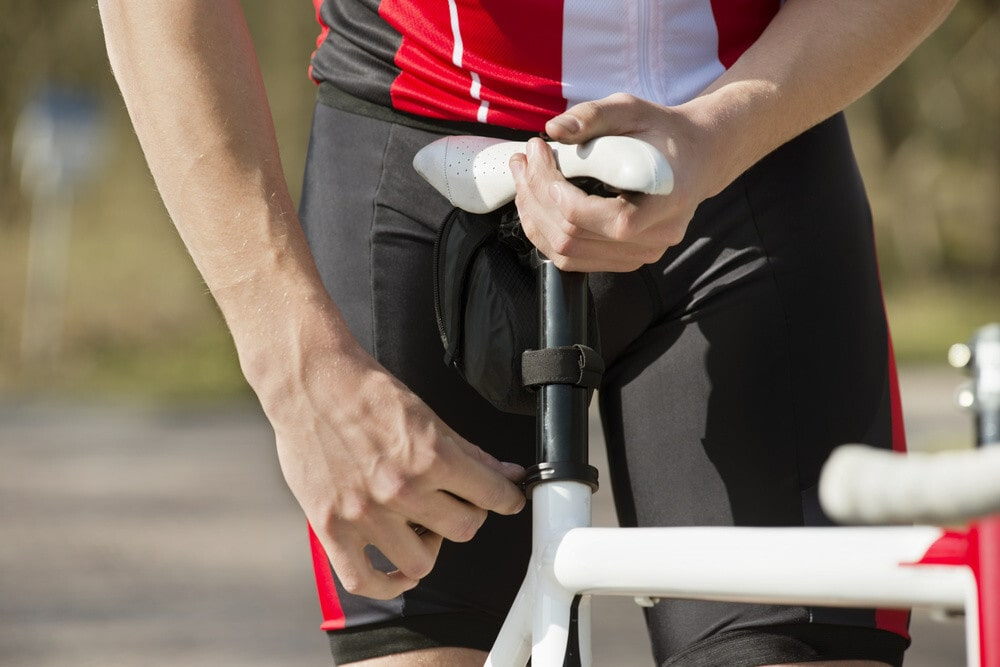 Loosening the side bolts of the bike seat
